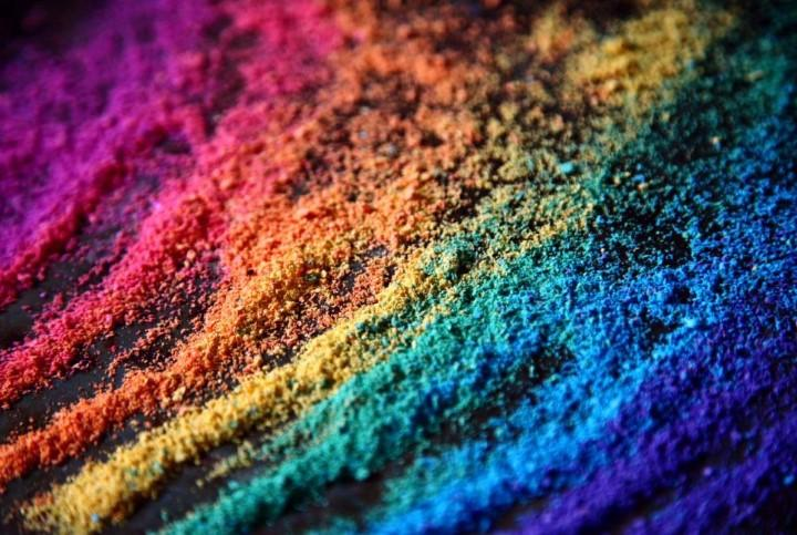 Multi colored piles of chalk dust